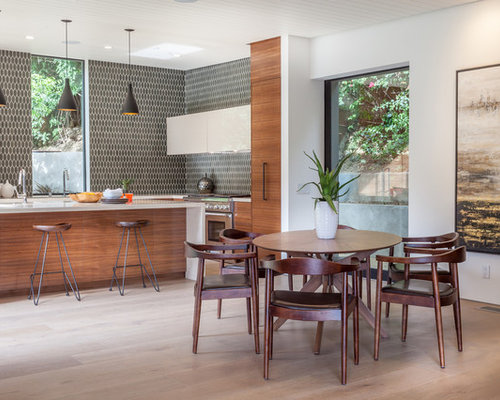 Mid Sized Contemporary Light Wood Floor And Beige Great Room Idea In Los Angeles