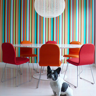 Dining room - contemporary painted wood floor and white floor dining room idea in New York with multicolored walls