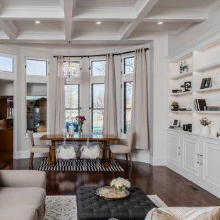 Foto de comedor casetón, tradicional renovado, de tamaño medio, abierto, con paredes blancas, marco de chimenea de baldosas y/o azulejos y suelo marrón