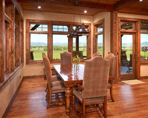 southwestern kitchendining combo idea in denver with beige walls dark hardwood floors and