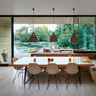 Photo Of A Medium Sized Nautical Open Plan Dining Room In London With White Walls