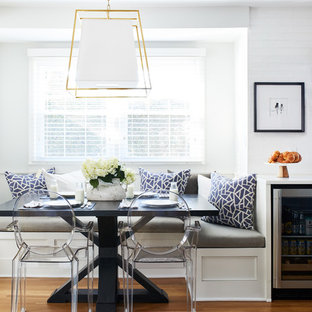 Example of a mid-sized transitional medium tone wood floor and brown floor kitchen/dining room combo design in DC Metro with white walls