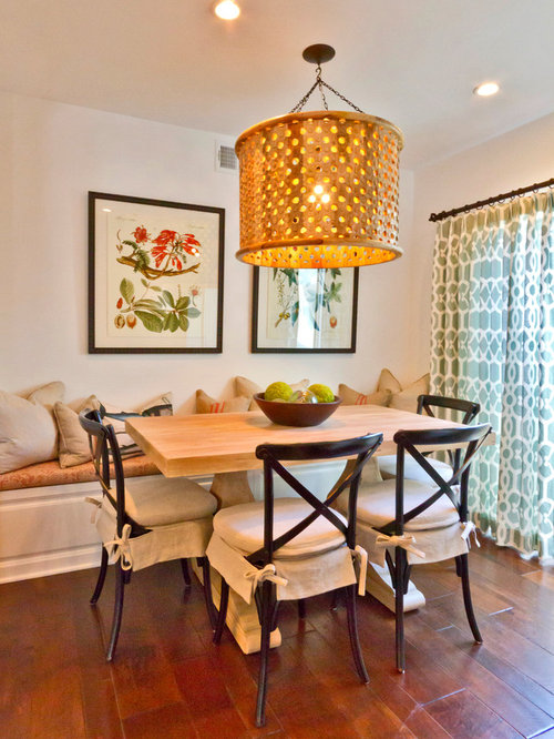 Inspiration For An Eclectic Dark Wood Floor Dining Room Remodel In Orange County With White Walls