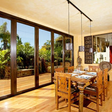 Tropical Dining Room by Marrokal Design & Remodeling