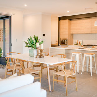 Contemporary open plan dining in Sydney with white walls.