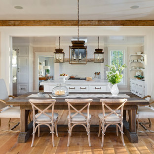 Example Of A Mountain Style Medium Tone Wood Floor Kitchen Dining Room Combo Design In