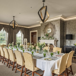 This is an example of a classic dining room in Surrey with grey walls, a standard fireplace and brown floors.