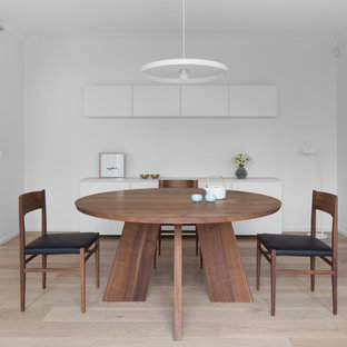 Design ideas for a contemporary dining room in Melbourne with white walls, light hardwood floors and beige floor.