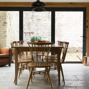 Inspiration for a large scandi open plan dining room in Other with white walls and limestone flooring.