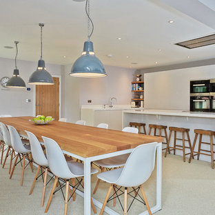 This Is An Example Of A Contemporary Kitchen/dining Room In Other With Grey  Walls