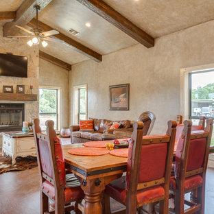 Diseño de comedor rústico, de tamaño medio, abierto, con paredes beige, suelo vinílico, chimenea tradicional, marco de chimenea de piedra y suelo marrón