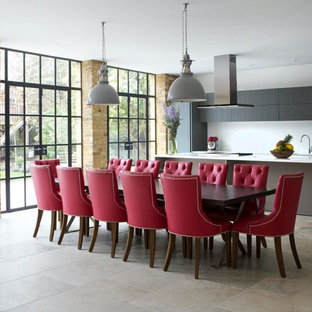 Photo of a medium sized contemporary kitchen/dining room in Wiltshire with white walls and grey floors.