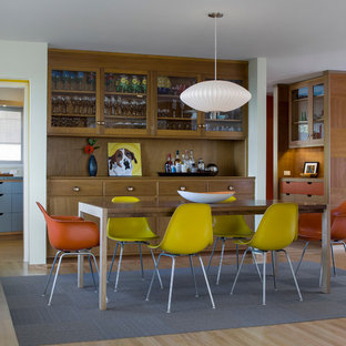 Example of a trendy medium tone wood floor dining room design in San Francisco with white walls