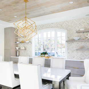 Inspiration for a nautical dining room in Orange County with beige walls.