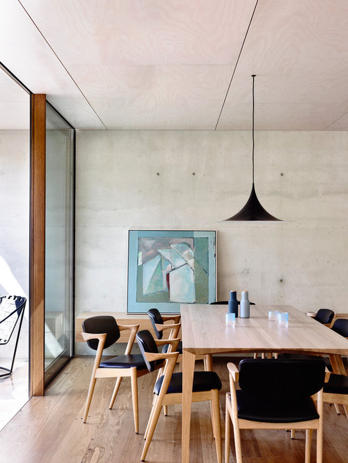 This Is An Example Of A Small Modern Kitchen Dining Combo In Melbourne With Grey