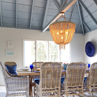 Example of a coastal light wood floor dining room design in San Diego with white walls