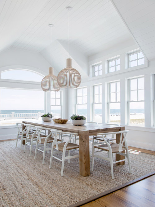 Coastal Dining Room Photo In New York With White Walls Medium Tone Wood Floors And