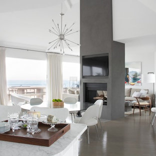 Example of a trendy medium tone wood floor great room design in New York with white walls, a two-sided fireplace and a concrete fireplace
