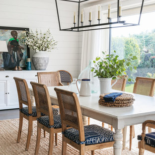 Inspiration for a medium sized coastal enclosed dining room in Sussex with white walls, no fireplace and grey floors.