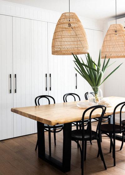 Beach Style Dining Room by Hannah Puechmarin