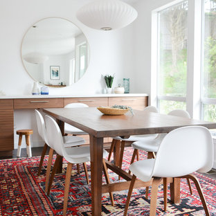 Example of a beach style dining room design in San Francisco with white walls