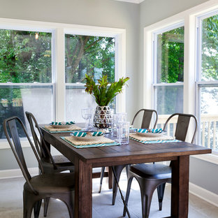 Beach style dining room photo in Charlotte with gray walls