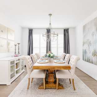 Inspiration for a beach style light wood floor enclosed dining room remodel in Houston with white walls and no fireplace