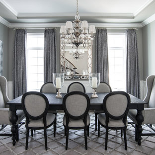Elegant dark wood floor dining room photo in Chicago with gray walls