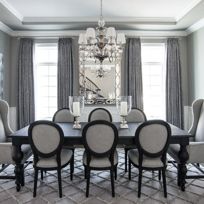 Elegant dark wood floor dining room photo in Chicago with gray walls and no fireplace