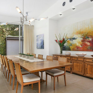 Inspiration for an expansive contemporary dining room in Sydney with white walls and limestone floors.