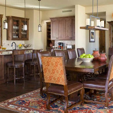Traditional Dining Room by CHC Mountain Structures