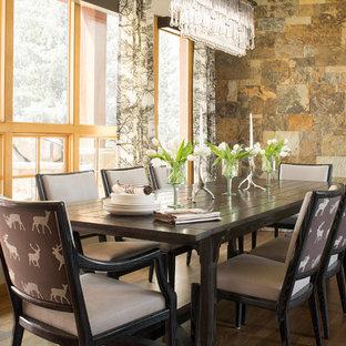 Inspiration for a rustic dark wood floor dining room remodel in Denver