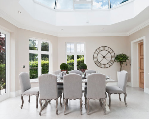 Inspiration For A Modern Enclosed Dining Room Remodel In London With Beige Walls