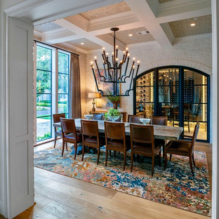 Inspiration for a large transitional light wood floor and beige floor enclosed dining room remodel in Houston with beige walls