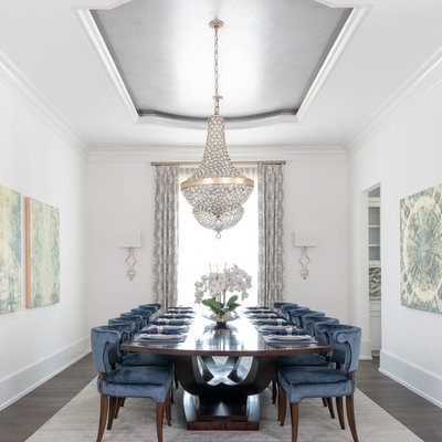 Enclosed dining room - transitional dark wood floor and brown floor enclosed dining room idea in Houston with white walls