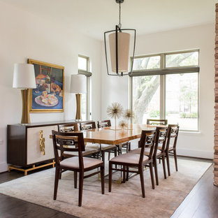 Example of a large transitional medium tone wood floor and brown floor enclosed dining room design in Houston with white walls and no fireplace