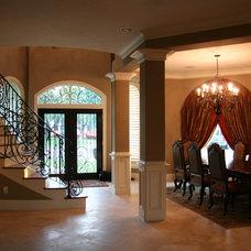 Mediterranean Dining Room by Savannah Construction
