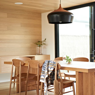 Trendy medium tone wood floor dining room photo in Geelong with beige walls