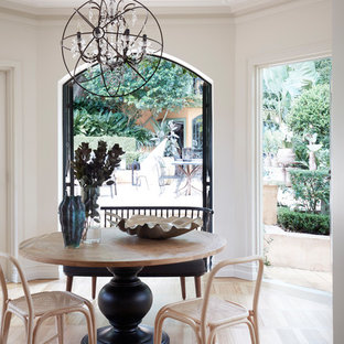 Transitional separate dining room in Sydney with white walls and light hardwood floors.