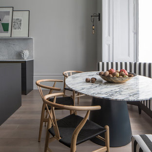Example Of A Trendy Dining Room Design In London With Gray Walls