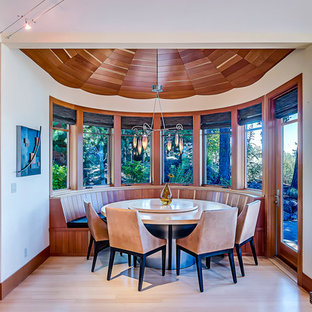 Dining room - contemporary bamboo floor dining room idea in Other