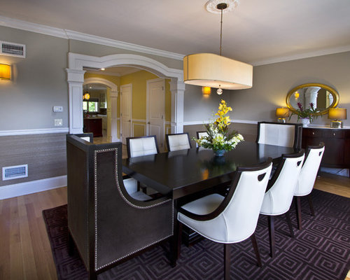 Example Of A Trendy Medium Tone Wood Floor Dining Room Design In New York With Gray