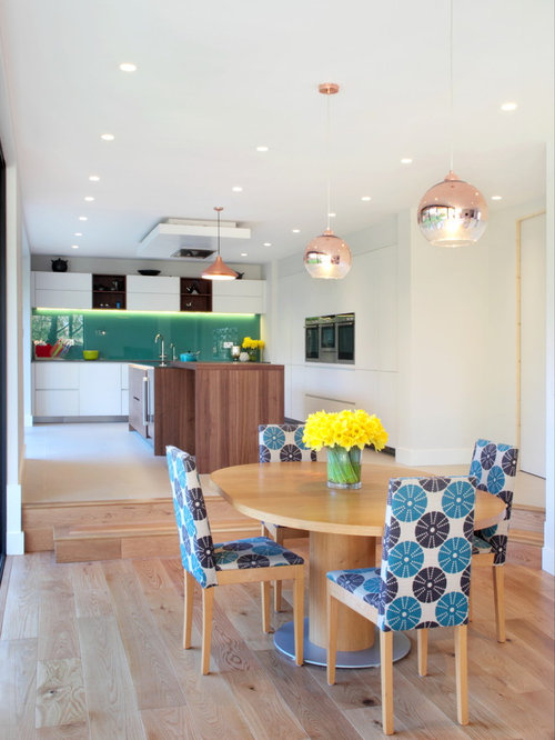 This Is An Example Of A Contemporary Kitchen Dining Room In Buckinghamshire With White Walls