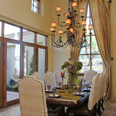 Mediterranean Dining Room by Murray Duncan Architects Inc.