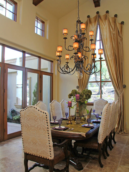 Example Of A Tuscan Dining Room Design In Sacramento With Beige Walls