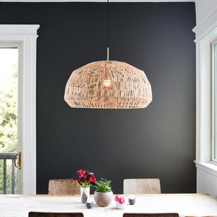 Small trendy kitchen/dining room combo photo in San Francisco with black walls