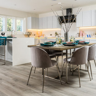 Photo of a contemporary kitchen/dining room in Dorset with beige walls, light hardwood flooring and grey floors.