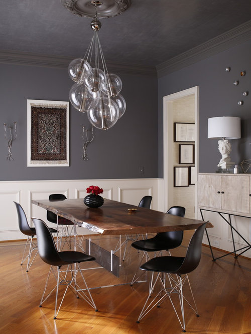 Inspiration For A Contemporary Medium Tone Wood Floor Enclosed Dining Room Remodel In Raleigh With Gray