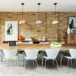 ロンドンのコンテンポラリースタイルのおしゃれなダイニング (コンクリートの床) の写真