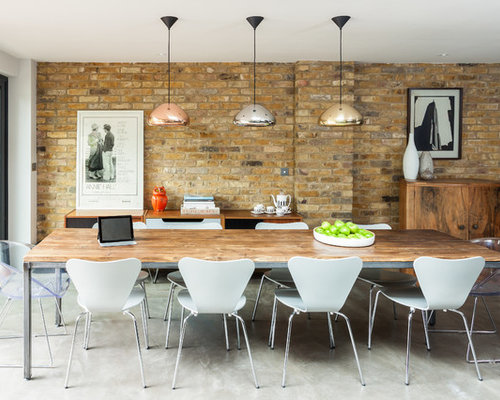 Great Trendy Concrete Floor Dining Room Photo In London